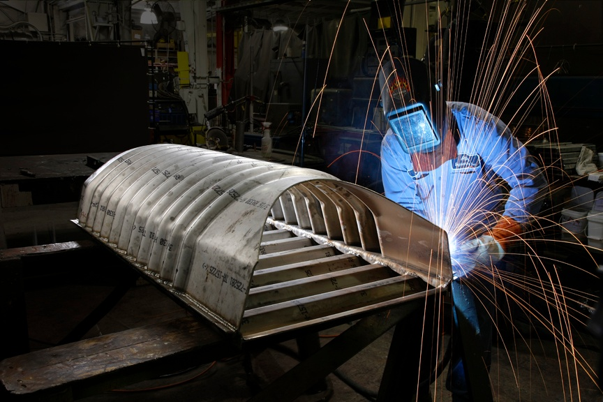 Welder on Muffle